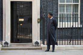 Buhari stads outside british parliament