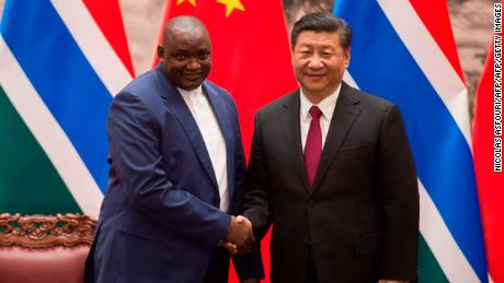 Gambia's President Adama Barrow with China's President Xi Jinping at the end of a signing ceremony at the Great Hall of the People in Beijing on December 21, 2017. The two countries re-established diplomatic relations in 2016.